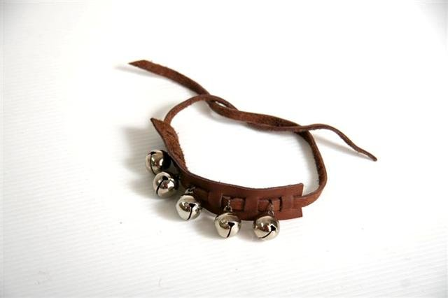 Leather wrist-band with multiple bells